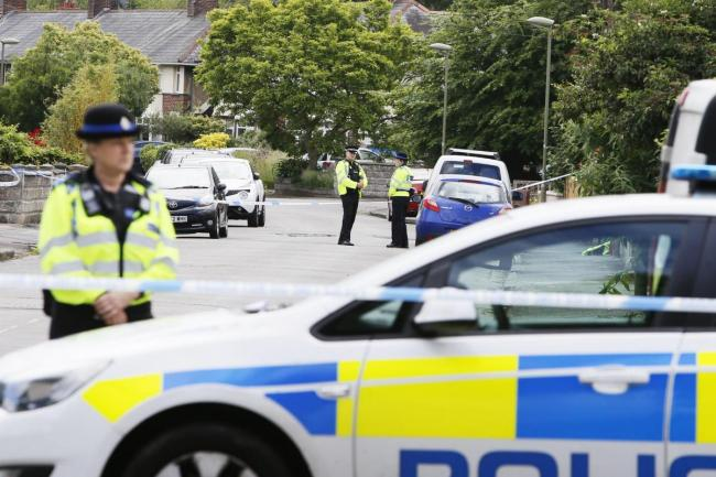 Police in Lytton Road after the woman was found dead