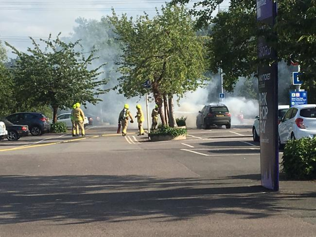 Firefighters tackle car blaze in park and ride