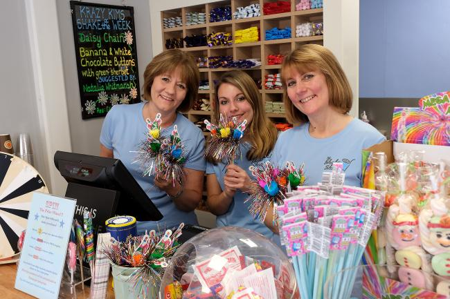 Kim Cook, left, and Debbie Hackett, right, from the very successful Shake Shop in Witney's High Street are opening their second branch in Carterton. They are pictured in the new shop with Debbie's daughter Eleanor Picture: Ric Mellis