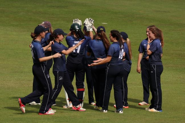 Oxon Girls Under 17s celebrate a wicket against Warwickshire