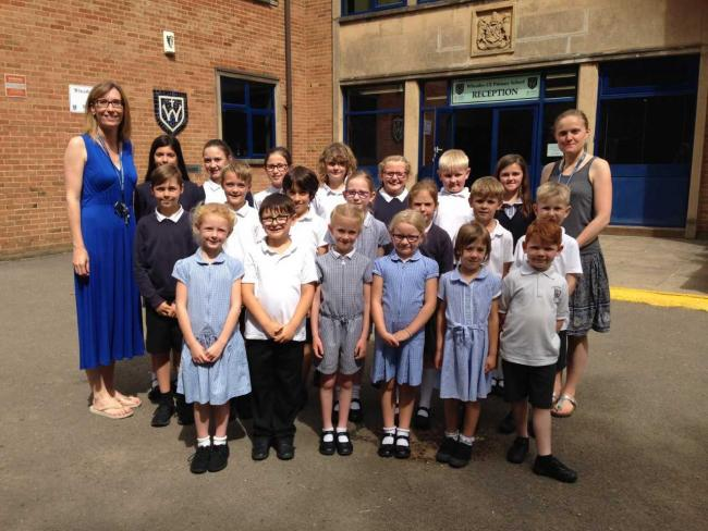 Co-Headteachers Gillian Standing and Anneka Fisher with some of the children from Wheatley CE Primary School. Picture by ODST