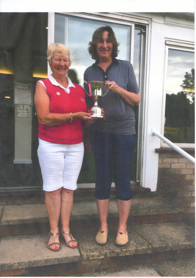 North Oxford ladies' champion Sue Stewart (right) receives the trophy from captain Linda Strange