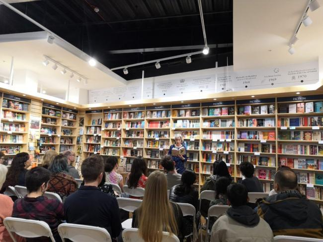 Debut author signs novel at bookstore