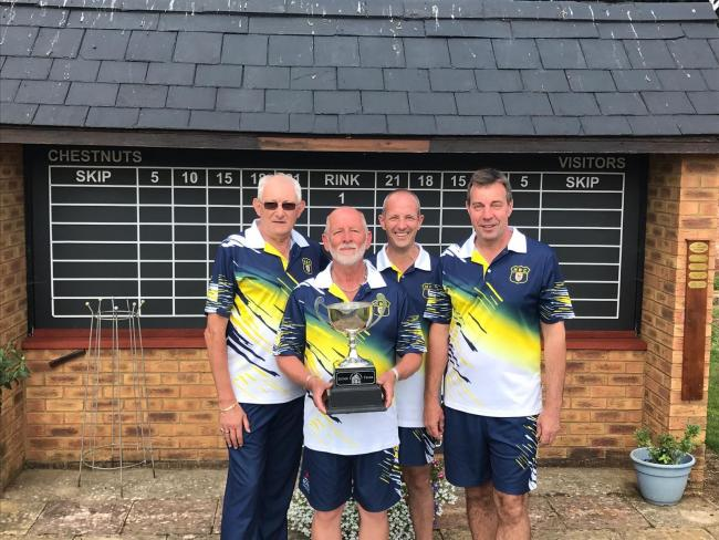 Headington's Bernie May, Paul Comley, Ray Gaskins and Howard Watts celebrate their win in the senior fours championship