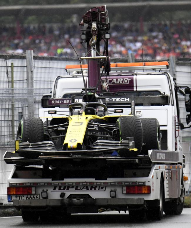 Daniel Ricciardo's Renault is carried by a truck after an exhaust issue forced the Australian to retire from the German Grand Prix at Hockenheim Picture: AP Photo/Jens Meyer