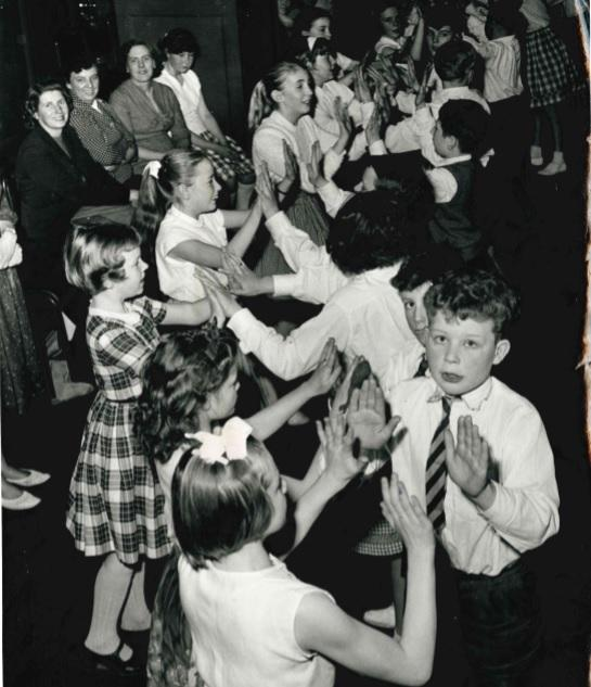 Children dancing to 'Nick Nack Paddy Whack' at Oxford Town Hall in March 1962