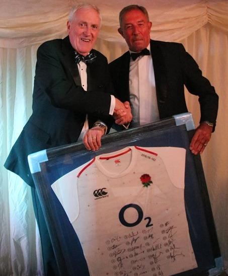 Danny Crump (left) accepts a signed England shirt from Oxfordshire's RFU Council representative Rob Walsh at the club's recent summer ball Picture: Witney RFC