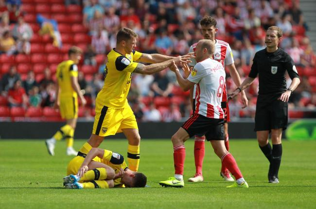 Jamie Mackie exchanges views with Sunderland's Dylan McGeouch on the opening day of the season    Picture: Richard Parkes