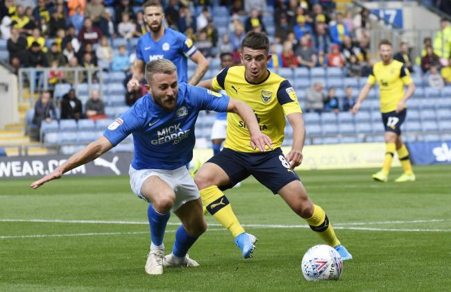 Cameron Brannagan battles for the ball in Oxford United's win against Peterborough United  Picture: David Fleming
