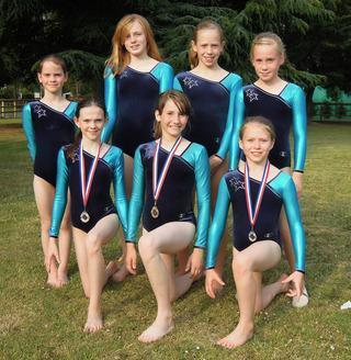 File photo of Kinetic Gymnastics Club medal winners in 2011: (front, from left): Courteney Taylor, Theresa Demmel and Lucy Washbourne-Calcut, with clubmates at the back: Lily Gatenby, Emma Critchley, Laura Hayler and Charlie Critchley.