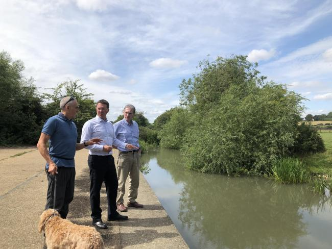 Witney MP Robert Courts, centre, with Ashley Smith, left, and Peter Hammond, right, of the Windrush Against Sewage Pollution group Picture: WASP