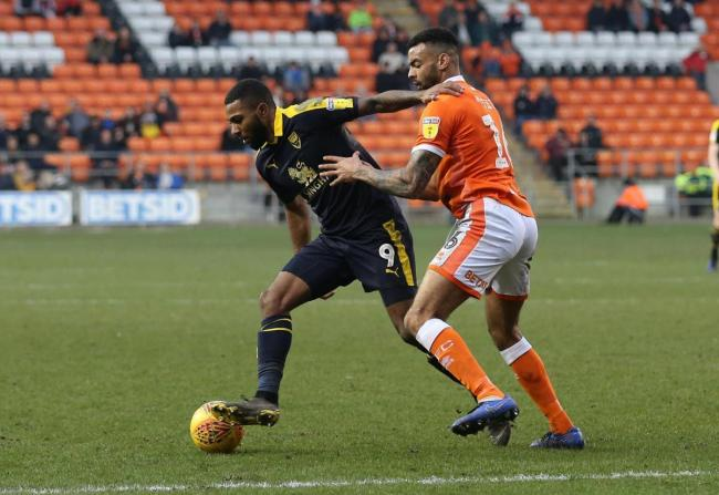 Oxford United's Jerome Sinclair shields the ball from Blackpool's Curtis Tilt during February's win Picture: Richard Parkes
