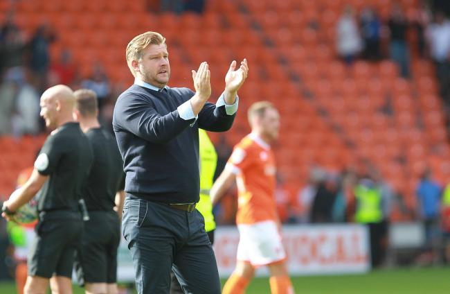 Oxford United head coach Karl Robinson applauds the travelling fans at Blackpool  Picture: Richard Parkes
