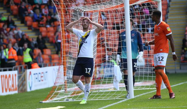 James Henry cannot believe it as another Oxford United chance goes begging in the second half at Blackpool   Picture: Richard Parkes