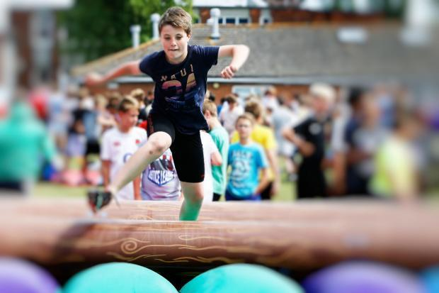Harry Storey pictured taking part in activities at a St Birinus School fundraiser in 2017