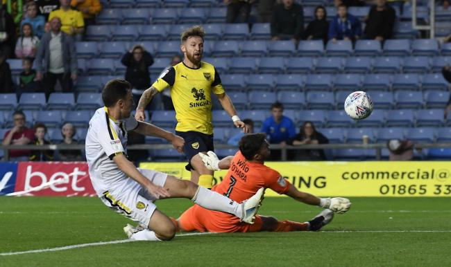 New Oxford United signing Matty Taylor is denied in the first half by Burton Albion goalkeeper Kieran O'Hara   Picture: David Fleming