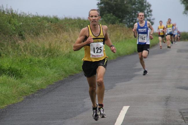 Race winner James Bolton leads the way at the Alchester 5k Picture: Barry Cornelius
