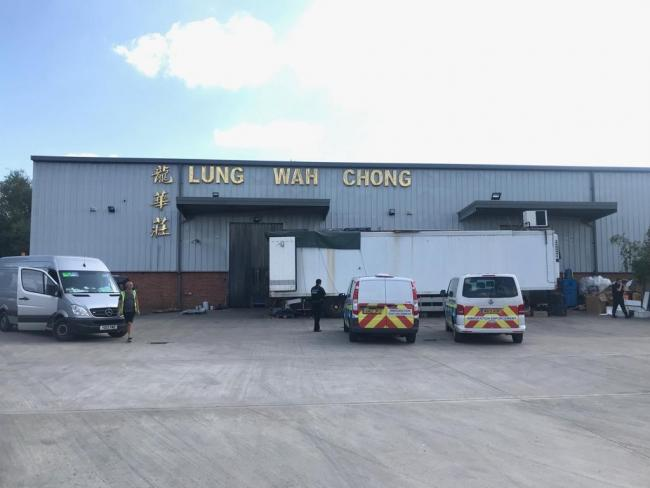 Immigration vans pull up at Lung Wah Chong in Osney Mead. Pic by Fran Way