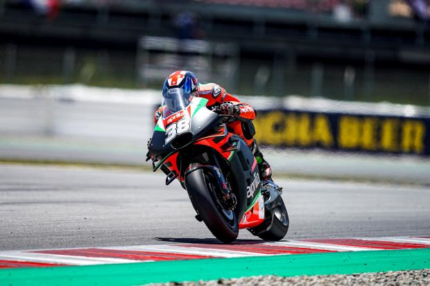 Bradley Smith during the Catalunya MotoGP earlier this season - one of his wildcard races as Aprilia's test rider Picture: Aprilia Racing