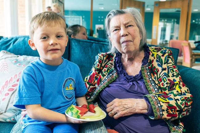Four-year-old Flynn from Little Ducks Pre-School, Childrey, with his friend Marigold Best at Richmond Village care home, Letcombe Regis.