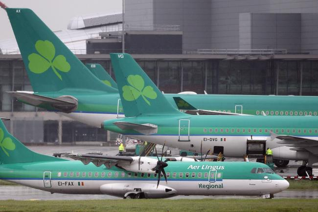 Aer Lingus customers are unable to download their boarding passes and may have to queue at the airport (Niall Carson/PA)