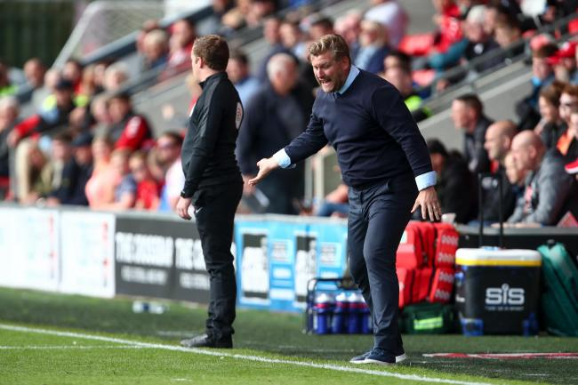 An animated Karl Robinson on the touchline