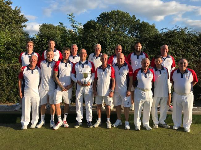 Captain Andy McIntyre and West Witney Bowls Club celebrate winning the Oxford & District League Cup for the first time