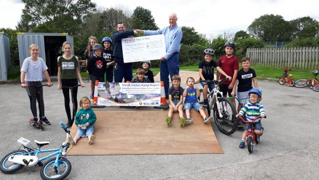 Young skaters and BMXers at the Marsh Gibbon Parish Council Ramp project near Bicester being awarded a £1,000 grant by Bicester Tesco.