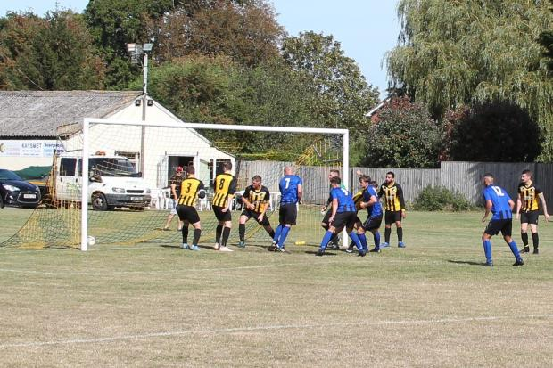 George Rycroft (8) scores East Hendred's second goal