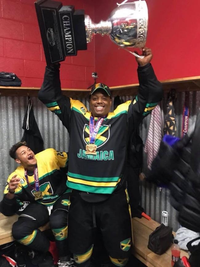 Marlon Williams, from Kidlington, holds up the Amerigol LATAM Cup after being part of the victorious Jamaican team.