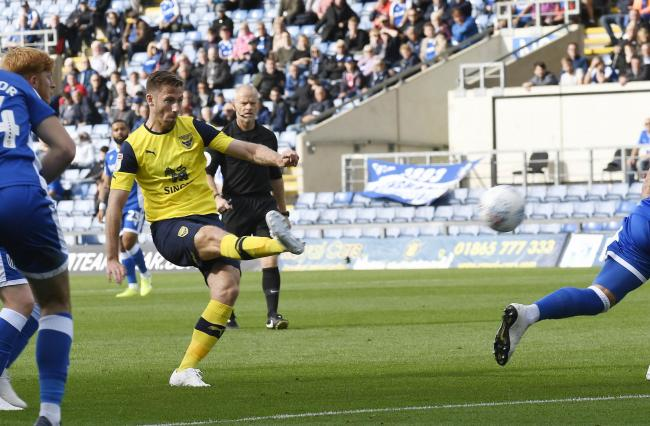 James Henry opens the scoring for Oxford United against Gillingham  Picture: David Fleming