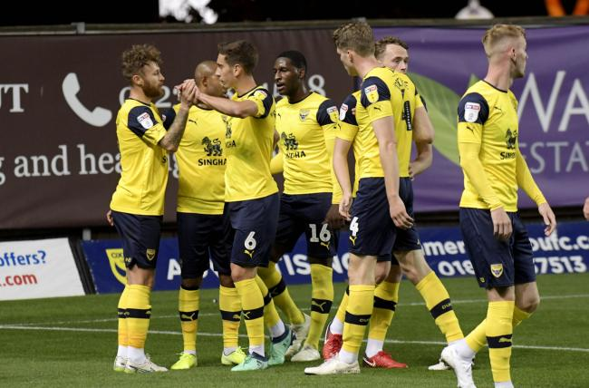 Matty Taylor is congratulated after opening the scoring for Oxford United  Picture: David Fleming