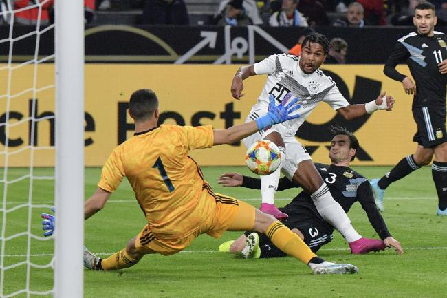 Serge Gnabry, centre, scores Germany's first goal
