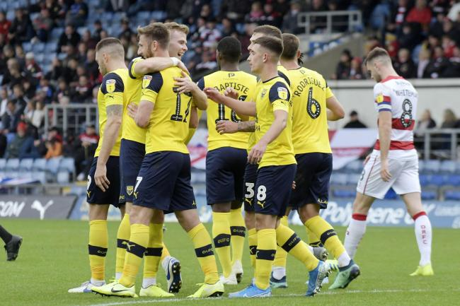 James Henry is congratulated after scoring his second and Oxford United's third goal against Doncaster Rovers   Picture: David Fleming