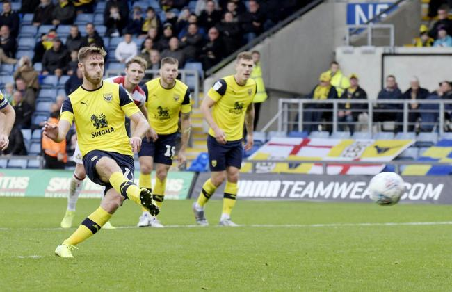 James Henry slots home the penalty to put Oxford United 3-0 up against Doncaster Rovers  Picture: David Fleming