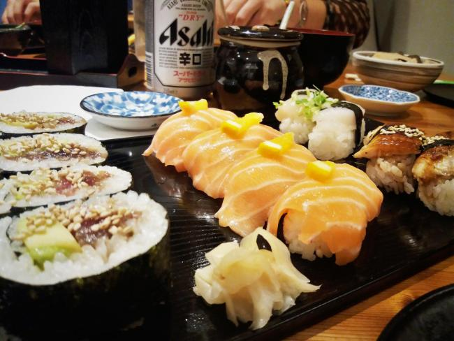 A sushi platter including, from left, tuna and avocado rolls, salmon and orange sushi, pickled ginger, scallop nigirizushi and unagi eel. Picture: Pete Hughes