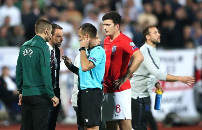 England boss Gareth Southgate speaks to referee Ivan Bebek during one of the stoppages for racist chanting  Picture: Nick Potts/PA Wire