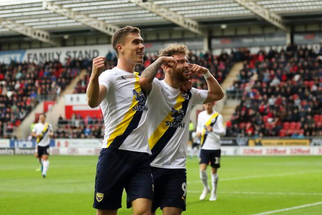 Oxford United would love to agree a permanent move for on-loan striker Matty Taylor (right) during the January transfer window, while recruiting back-up for Josh Ruffels (left) is also a priority  Picture: James Williamson