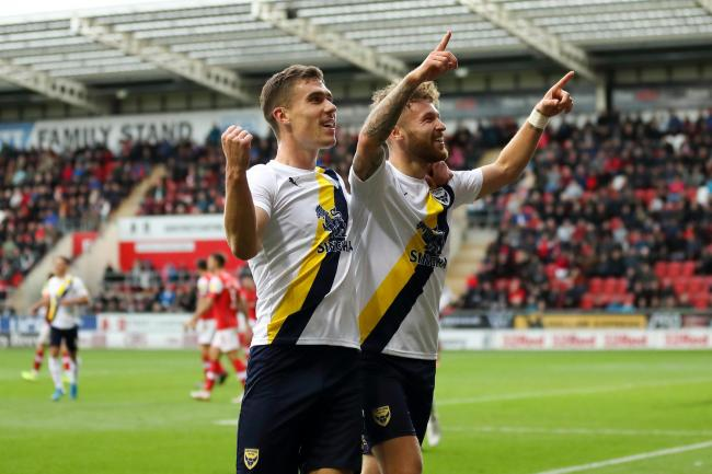 Matty Taylor (right) celebrates his winner for Oxford United at Rotherham United in October. A similarly challenging clash is expected for the return game tomorrow         Picture: James Williamson