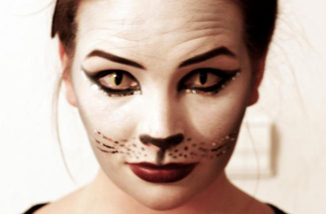 Girl in Cat disguise with cat contact lenses, kitten ears