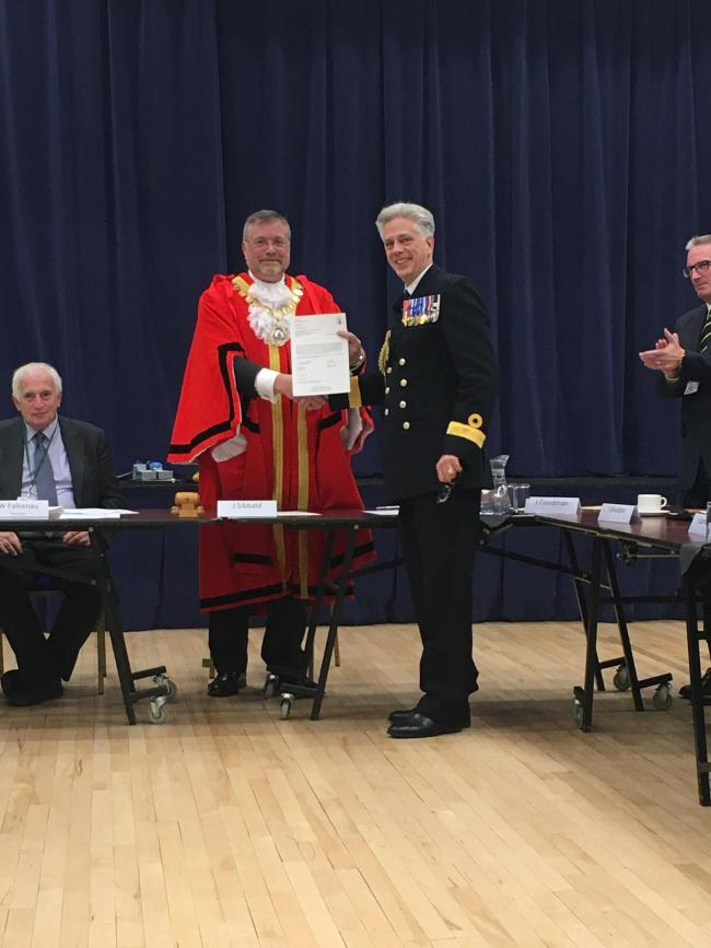 Jim Sibbald, mayor of Wantage, presents a certificate for the freedom of the town to Commodore David Elford.