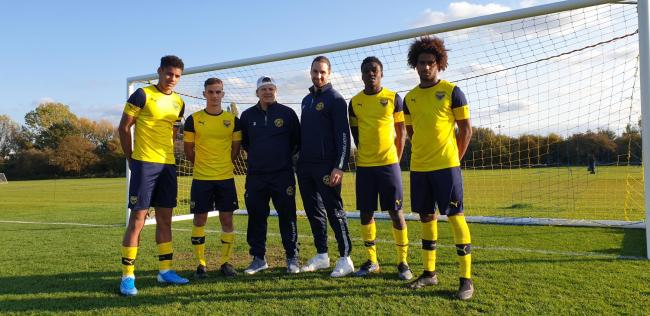 Oxford City Stars captain Josh Florey and assistant skipper Alex Staples with Oxford United rising stars Kyran Lofthouse, Fabio Sole, Kevin Berkoe and Fabio Lopes