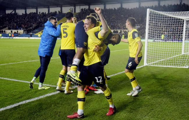 Sam Long lifts Oxford United goal hero Rob Hall at the end of the Sunderland  Picture: David Fleming