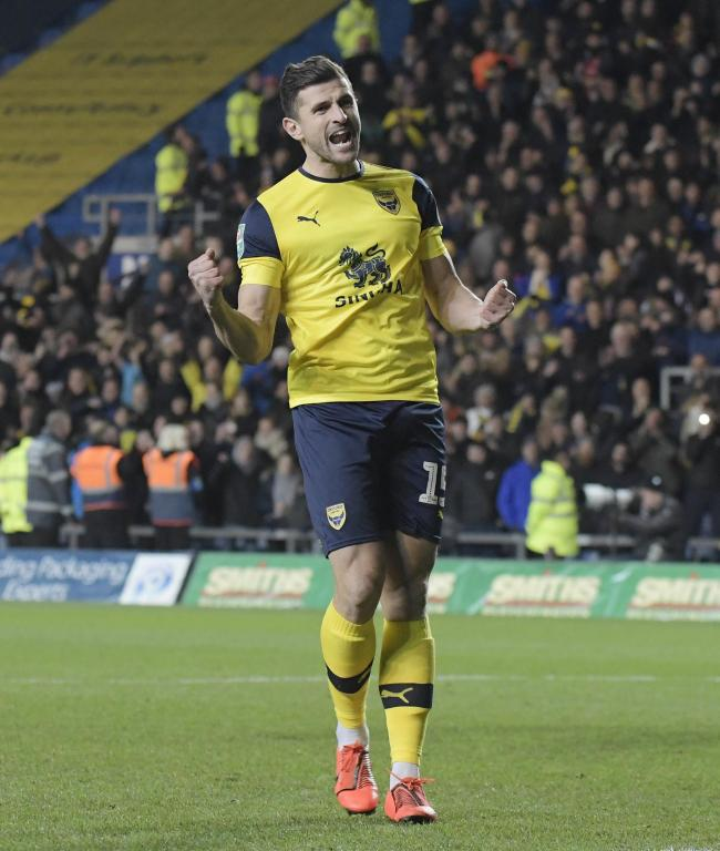 John Mousinho celebrates scoring his penalty for Oxford United in the Carabao Cup shoot-out against Sunderland  Picture: David Fleming