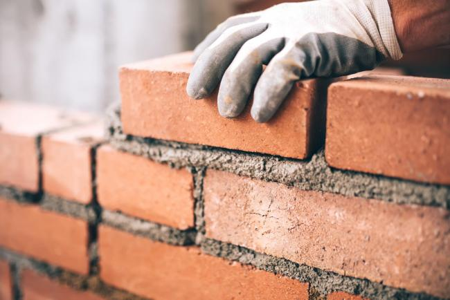 File photo of a bricklayer on a construction site