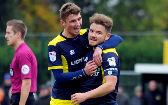 Ryan Ledson celebrates Alex MacDonald's opening goal for Oxford United at Merstham  Picture: David Fleming