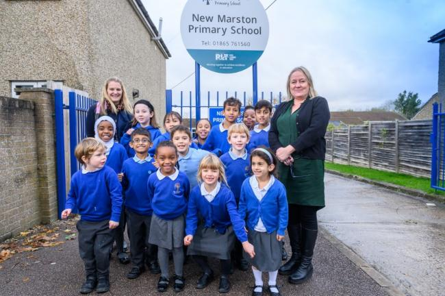 Children and staff including headteacher Tracey Smith (right) and school inclusion leader Rachel Vlachonikolis (left) are celebrating a 'good' Ofsted at New Marston Primary School