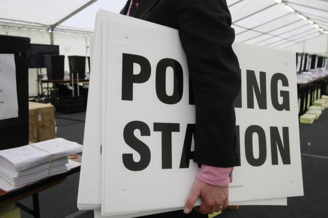 Ballot boxes and polling station signs.