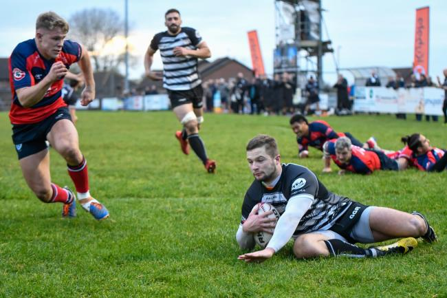 Josh Hodson dives over for Chinnor's sixth try against Sale   Picture: Simon Cooper