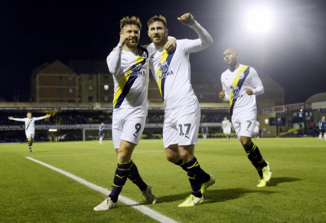 Matty Taylor and James Henry celebrate Oxford United's win at Southend Picture: David Fleming